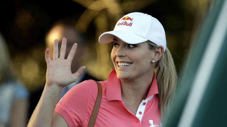 Skier Lindsey Vonn waves after watching Tiger Woods during the second round of the Masters golf tournament Friday, April 12, 2013, in Augusta, Ga. (AP Photo/David Goldman)