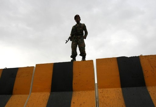 A Yemeni soldier keeps guard in Sanaa. Yemeni militia have killed an Al-Qaeda prisoner who tried to escape but a local militant leader managed to flee as they found an explosives lab in a separate incident, a militia source has said