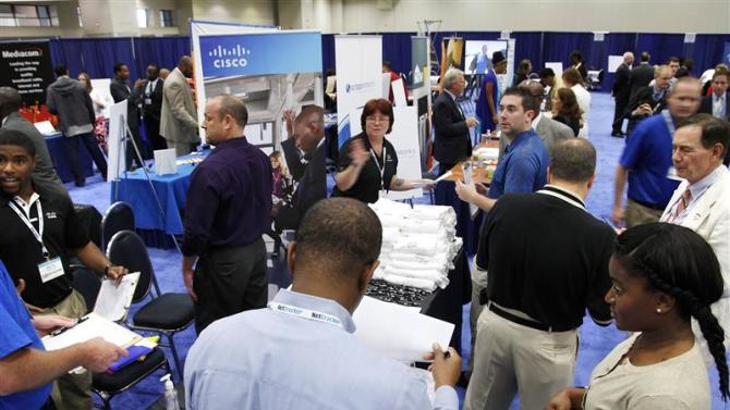 Jobseekers talk with recruiters at a Hire Our Heroes job fair in Washington