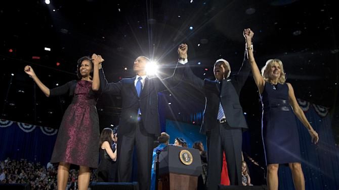 President Barack Obama, first lady Michelle Obama, Vice President Joe Biden and Jill Biden acknowledge the crowd at his election night party Wednesday, Nov. 7, 2012, in Chicago. President Obama defeated Republican challenger former Massachusetts Gov. Mitt Romney. (AP Photo/Carolyn Kaster)