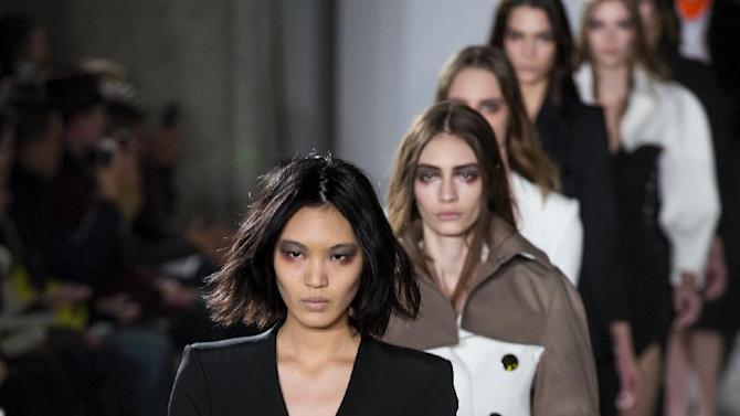 Models walk the runway at the presentation of the Altuzarra Fall 2013 fashion collection during Fashion Week, Saturday, Feb. 9, 2013, in New York. (AP Photo/Craig Ruttle)