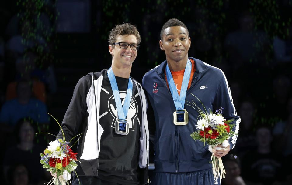 Anthony Ervin, left, and Cullen Jones pose during the medal ceremony for the men's 50-meter freestyle at the U.S. Olympic swimming trials on Sunday, July 1, 2012, in Omaha, Neb. (AP Photo/Mark Humphrey)