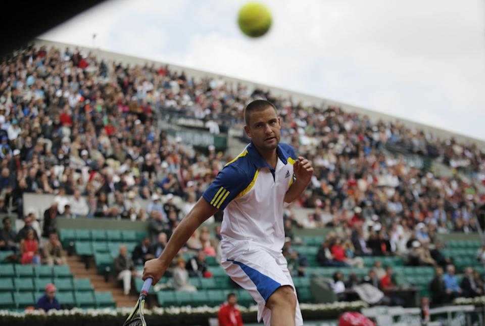 Russia's Mikhail Youzhny watches the ball after a point as he plays Germany's Tommy Hass during their fourth round match of the French Open tennis tournament at the Roland Garros stadium Monday, June 3, 2013 in Paris. Haas won 6-1, 6-1, 6-3. (AP Photo/Christophe Ena)