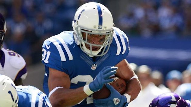 Indianapolis Colts running back Donald Brown carries the ball in an NFL match against Minnesota Vikings