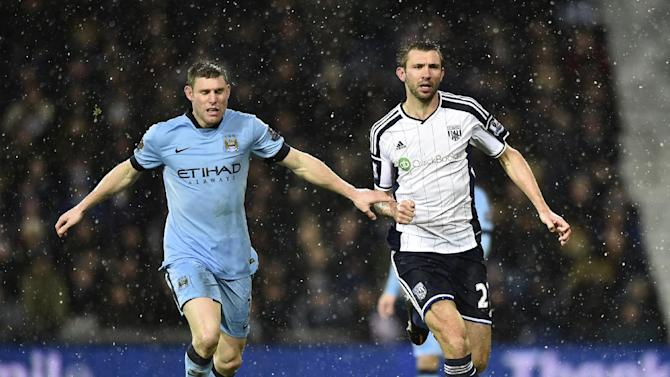 Manchester City's James Milner challenges West Bromwich Albion's Gareth McAuley during their English Premier League soccer match at The Hawthorns in West Bromwich