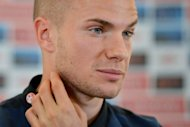 England footballer Tom Cleverley listens to questions during a press conference at The Grove hotel north of London. Cleverley admits his experience at the Olympics played a key role in his rise to prominence with England