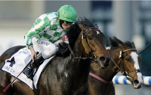 "Moore, riding Lines of Battle of the U.S,. races towards the finish line during the fourth race ""UAE Derby"" of the Dubai World Cup at the Meydan Racecourse in Dubai"