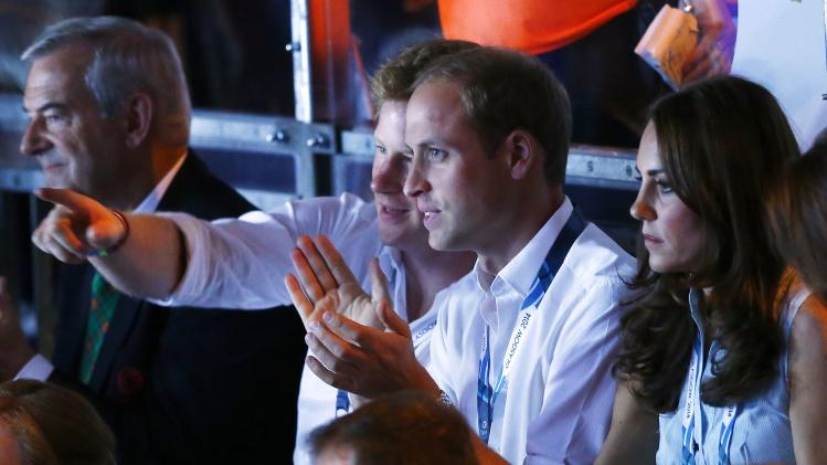 Britain's Prince Harry, Prince William and his wife Catherine, Duchess of Cambridge, watch a boxing match at the SECC during the 2014 Commonwealth Games in Glasgow