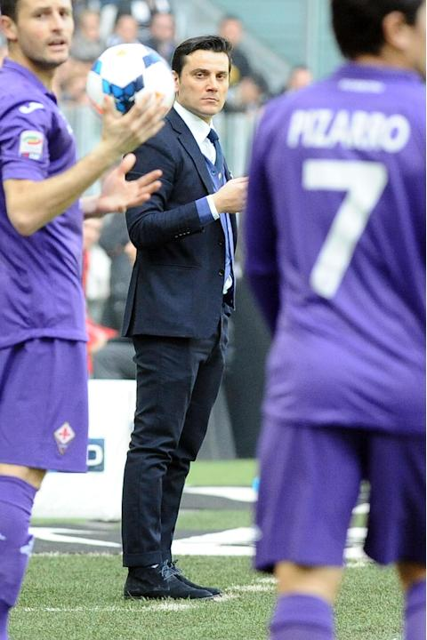 Fiorentina coach Vincenzo Montella follows a Serie A soccer match between Juventus and Fiorentina at the Juventus stadium, in Turin, Italy, Sunday, March 9, 2014