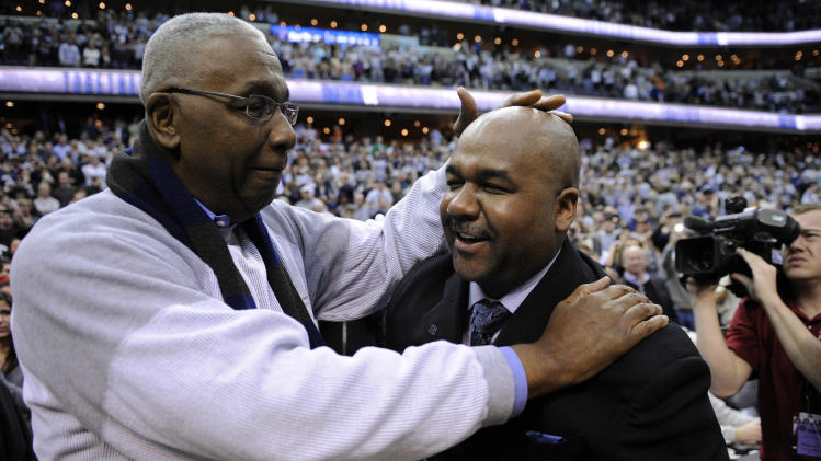 John Thompson Jr., left, congratulates his son Georgetown head coach John Thompson III, right, after an NCAA college basketball game, Saturday, March 9, 2013, in Washington. Georgetown won 61-39 over Syracuse. (AP Photo/Nick Wass)
