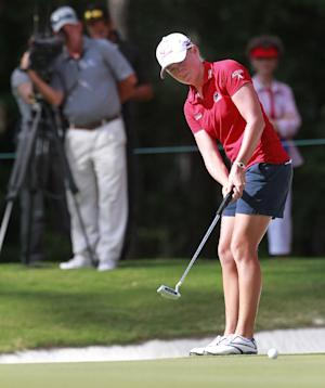 Stacey Lewis putts on the 18th green during the third round of the Mobile Bay LPGA Classic golf tournament, Saturday, April 28, 2012, in Mobile, Ala. (AP Photo/Press-Register, Bill Starling) MAGS OUT