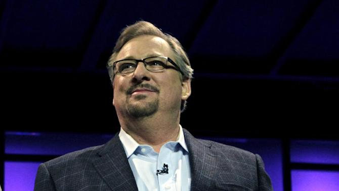 FILE - In this Nov. 29, 2010, file photo, Pastor Rick Warren acknowledges audience members during the Saddleback Civil Forum on Leadership and Service in Lake Forest, Calif. Saddleback Valley Community Church said in a statement Saturday, April 6, 2013, that Warren's 27-year-old son, Matthew Warren,  has committed suicide after struggling with mental illness and deep depression. (AP Photo/Jae C. Hong, File)