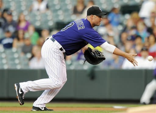 Cuddyer homers as Rockies beat Marlins, 5-3