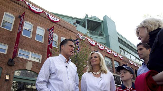 """FILE - In this April 16, 2012 file photo, Republican presidential candidate, former Massachusetts Gov. Mitt Romney and his wife Ann, are seen outside Fenway Park baseball stadium in Boston. Don't bet on Mitt Romney winning his home state. Or even trying. """"That's not been a topic of discussion,"""" Romney campaign adviser Kevin Madden said when asked if the Republican former Massachusetts governor would compete in the heavily Democratic state.   (AP Photo/Steven Senne)"""