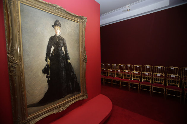"The painting by Eduard Manet, The Parisian, (1875), hangs on the mirrored catwalk during the press day of the Impressionism Fashion exhibition in at the Orsay museum in Paris, Friday, Sept. 21, 2012. To coincide with Paris Fashion week, a new and highly original exhibit called ""Impressionism and Fashion"" opens at the Musee d'Orsay. It uses famous works of art to explore how at the dawn of impressionism, and as an emblem of ""modernite"" fashion, and how people dressed, became one of the main themes in art. The exhibition will open September 25, 2012 and last till January 2013. (AP Photo/Michel Euler)"