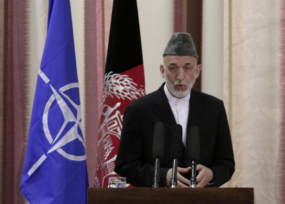 Afghan President Hamid Karzai speaks during a ceremony at military academy on the outskirts of Kabul, Afghanistan, Tuesday, June 18, 2013. Karzai announced at the ceremony that his country's armed forces are taking over the lead for security nationwide from the U.S.-led NATO coalition. (AP Photo/Rahmat Gul)