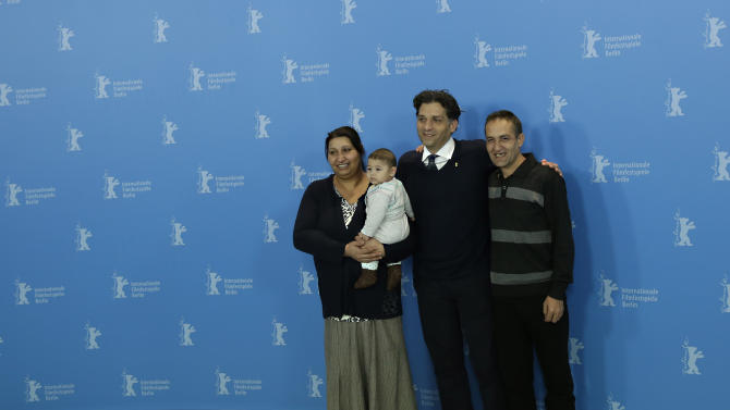 From left, actress Senada Alimanovic holding baby Danis, director Danis Tanovic and actor Nazif Mujic pose for the photo call of the film An Episode in the Life of an Iron Picker at the 63rd edition of the Berlinale, International Film Festival in Berlin, Wednesday, Feb. 13, 2013. (AP Photo/Markus Schreiber)