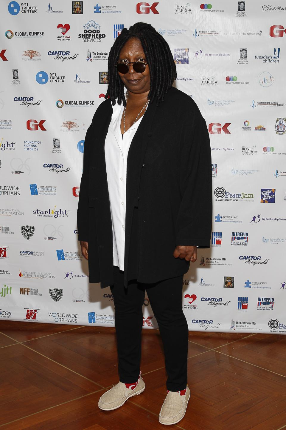 Whoopi Goldberg arrives at the Annual Charity Day hosted by Cantor Fitzgerald and BGC Partners, on Wednesday, Sept. 11, 2013, in New York. (Photo by Mark Von Holden/Invision/AP)