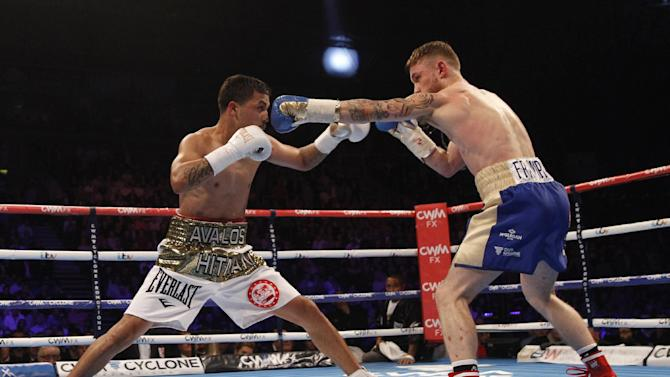World champion Carl Frampton, right, lands a punch on Chris Avalos of the U.S. during their IBF super bantamweight world title fight at the Odyssey arena in Belfast, Northern Ireland, Saturday, Feb. 28, 2015. (AP Photo/Peter Morrison)