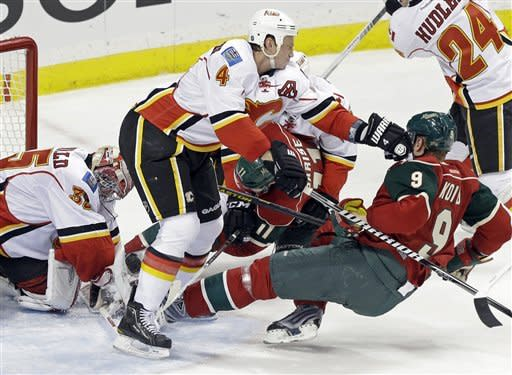 Parise's goal lifts Wild over Flames 2-1 in OT