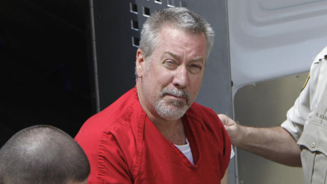 FILE - In this May 8, 2009 file photo, former Bolingbrook, Ill., police sergeant Drew Peterson arrives at the Will County Courthouse in Joliet, Ill., for his arraignment on charges of first-degree murder in the 2004 death of his third wife. On Tuesday, March 3, 2015, Peterson is expected in court at the Randolph Couty Courthouse in Chester, Ill., for a preliminary hearing on charges that he tried to hire someone to kill the Will County prosecutor who helped put him in state prison. (AP Photo/M. Spencer Green, File)