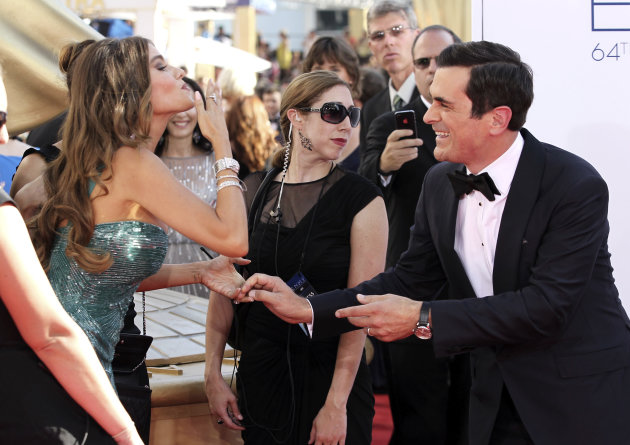 Sofia Vergara, left, and Ty Burrell, right, of &quot;Modern Family&quot; arrive at the 64th Primetime Emmy Awards at the Nokia Theatre on Sunday, Sept. 23, 2012, in Los Angeles. (Photo by Matt Sayles/Invision/AP)