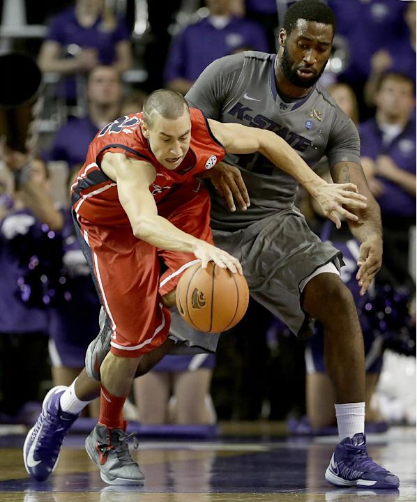 Kansas State's Thomas Gipson, right, tries to steal the ball from Mississippi's Marshall Henderson during the second half of an NCAA college basketball game Thursday, Dec. 5, 2013, in Manhatta