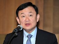 Thailand's Supreme Court has issued an arrest warrant for ousted premier Thaksin Shinawatra, seen here in November 2011, in the latest abuse of power charges brought against the controversial tycoon