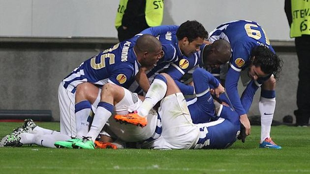 Porto players celebrate after Algerian forward Nabil Ghilas scored against Eintracht Frankfurt (AFP)