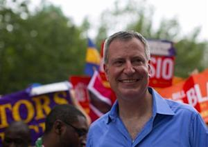 New York mayoral candidate Blasio participates in a march during the West Indian Day Parade in the Brooklyn borough of New York