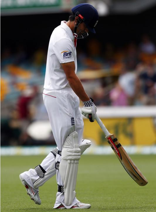 England's captain Cook walks off the field after his dismissal by Australia's Lyon during the fourth day's play of the first Ashes cricket test match in Brisbane