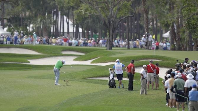 Rory Mcllroy hit his fourth shot from the first fairway during the first round of the Honda Classic golf tournament, Thursday, Feb. 26, 2015 in Palm Beach Gardens, Fla. McIlroy scored a 6 on the par 4 hole.  (AP Photo/Luis M. Alvarez)