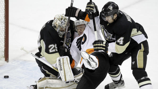 Philadelphia Flyers' Scott Hartnell (19) collides with Pittsburgh Penguins goalie Marc-Andre Fleury (29) and defenseman Zbynek Michalek (4) as the puck slides across the goal line for a first-period goal by Flyers' Claude Girous during an NHL hockey game in Pittsburgh, Sunday, April 1, 2012. Hartnell had an assist on the goal. (AP Photo/Gene J. Puskar)