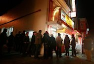 This file illustration photo shows a line stretching around the corner at Ben's Chili Bowl restaurant in Washington, DC. 'NoWait' app has spread to restaurants across the United States and into Canada and has been used to seat more than 3.3 million people since it launched in April of last year, according to one of its creators, Robb Myer