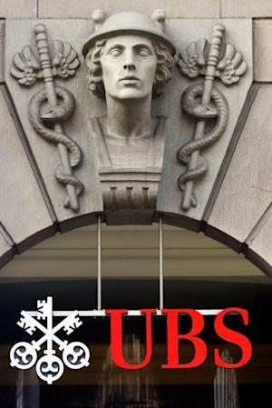 FILE - In this Jan. 13, 2006 file picture the UBS logo is photographed at UBS headquarters in Zurich, Switzerland. Swiss banking giant UBS AG announced massive layoffs Tuesday, Oct. 30, 2012, along with huge losses in its third-quarter results, saying it aims to trim as many as 10,000 employees, or some 15 percent of its staff, to drastically shrink its ailing investment bank. (AP Photo/Keystone, Steffen Schmidt, File)