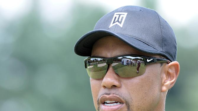 US golfer Tiger Woods leaves the course after his practice at the Congressional Country Club in Bethesda, Maryland on June 24, 2014