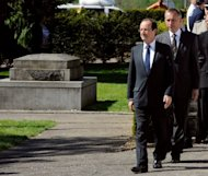 <p>French President-elect Francois Hollande (foreground) arrives for a war memorial ceremony in Tulle. The eurozone is heading for slow recovery from recession later this year but Spain and France will miss deficit targets, the EU said on Friday - piling pressure on countries already facing budget cuts.</p>