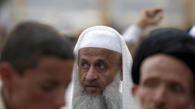 An elderly Yemeni man attends a rally held by pro-democracy protestors in Sanaa, Yemen, Friday, Dec. 28, 2012. (AP Photo/Hani Mohammed)