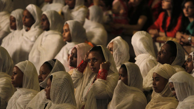 Ethiopian Christians, who live in Cairo, perform the Easter Mass lead by Pope Tawadros II, not pictured, at St. Mark's Cathedral in Cairo, Egypt, late Saturday May 4, 2013.  (AP Photo/Amr Nabil)