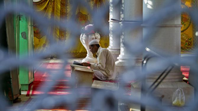 A Pakistani recites the Quran after offering his afternoon prayer at a mosque during the fasting month of Ramadan in Islamabad, Pakistan, Tuesday, July, 7, 2015. Muslims across the world are observing the holy fasting month of Ramadan, where they refrain from eating, drinking and smoking from dawn to dusk. (AP Photo/Anjum Naveed)