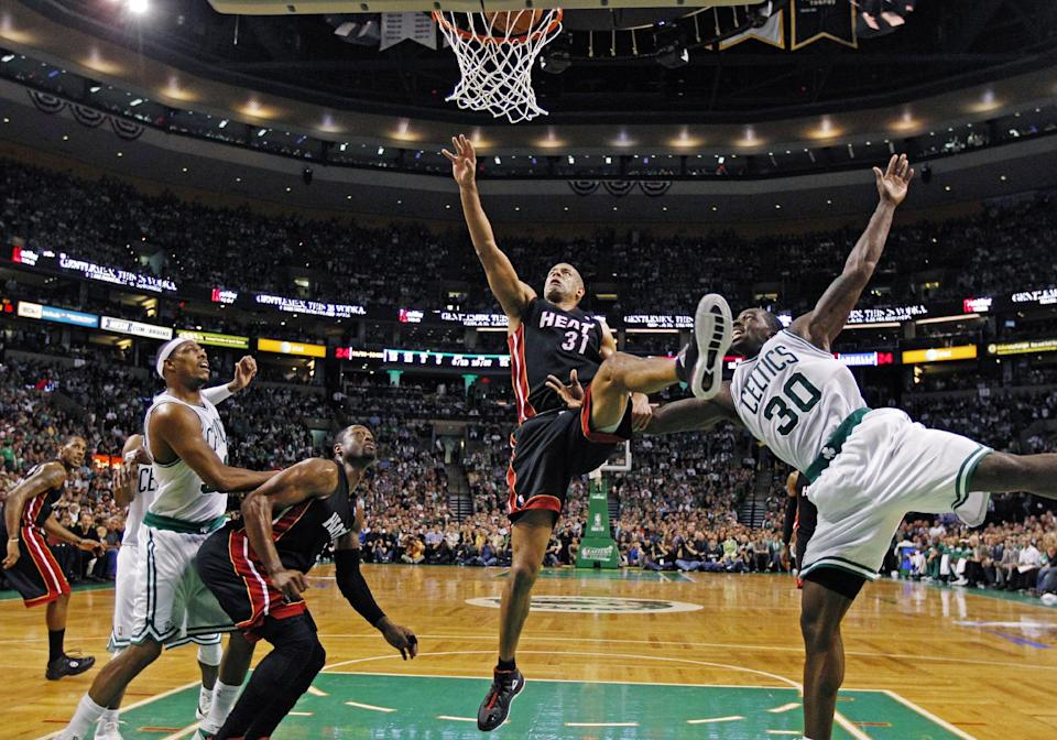 Miami Heat forward Shane Battier (31) shoots past Boston Celtics forward Brandon Bass (30) during the first half of Game 4 in their NBA basketball Eastern Conference finals playoffs series in Boston, Sunday, June 3, 2012. At left are Celtics forward Paul Pierce and Heat guard Dwyane Wade. (AP Photo/Charles Krupa)