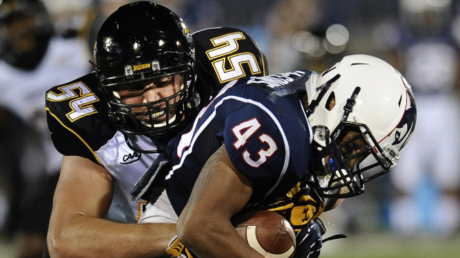 Towson from the FCS upsets Connecticut 33-18