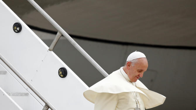 Pope Francis deplanes upon his arrival at the international airport in Rio de Janeiro, Brazil, Monday, July 22, 2013. During his seven-day visit, Francis will meet with legions of young Roman Catholics converging on Rio for the church's World Youth Day festival.(AP Photo/Jorge Saenz)