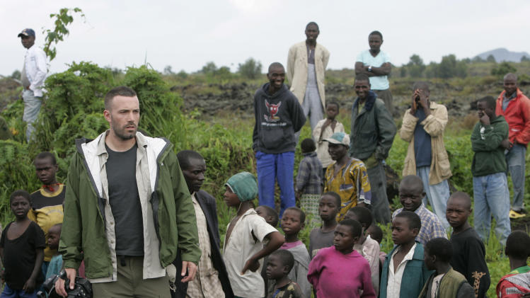 "FILE - This Nov. 19, 2008 file photo shows actor/director Ben Affleck walking through a camp for displaced people near Kibati just north of Goma in eastern Congo. Affleck is  managing to live a relatively private life in a Hollywood fishbowl. He married Jennifer Garner, had three kids, and cut down his ""compulsive"" work schedule to be with his family. He also founded the Eastern Congo Initiative in an effort to reduce the child mortality rate in the Congo.  (AP Photo/Karel Prinsloo, file)"