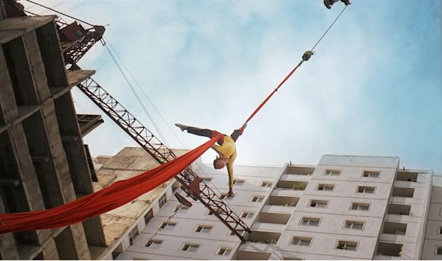 "In this image made out of film ""Comrade Kim Goes Flying"" released by Another Dimension of An Idea/Koryo Group, Comrade Kim Yong Mi played by Han Jong Sim is pulled up in the air by a crane. It's a cla"