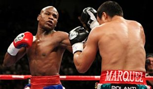 Floyd Mayweather Jr. throws a left to the body of Juan Manuel Marquez. (Getty)