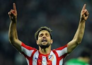 Atletico Madrid's Brazilian midfielder Diego celebrates after scoring during the UEFA Europa League final football match between Atletico Madrid and Athletic Bilbao at the National Arena stadium in Bucharest. A double by Colombian striker Radamel Falcao inspired Atletico Madrid to a 3-0 win over Athletic Bilbao and their second Europa League trophy in three seasons