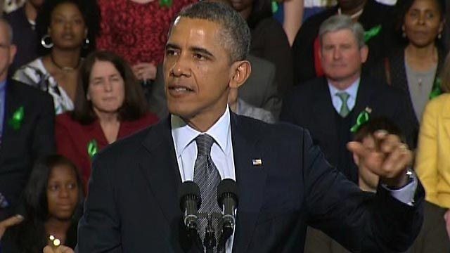 Obama takes gun control message to CT