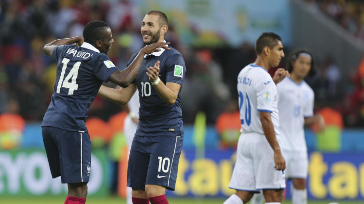 France's Karim Benzema (10) dances with Blaise Matuidi (14) after scoring the third goal during the group E World Cup soccer match between France and Honduras at the Estadio Beira-Rio in Porto Alegre, Brazil, Sunday, June 15, 2014. (AP Photo/David Vincent)