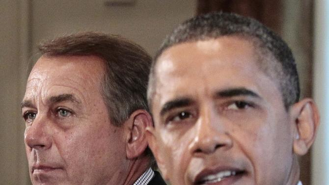 FILE - In this July 7, 2011 file photo, House Speaker John Boehner, of Ohio, listens at left as President Barack Obama speaks during a meeting with Congressional leadership to discuss the debt in the Cabinet Room of the White House in Washington. Back in the summer of 2011, as a debt crisis loomed much like one does again today, Obama issued a clear threat to Republicans: Without an agreement to raise the nation's borrowing limit, older Americans might not get their Social Security checks. He wasn't the first to issue such a warning in the face of a debt fight between an administration and Congress. The federal government could run out of cash to pay all its bills in full as early as Feb. 15, according to one authoritative estimate, and congressional Republicans want significant spending cuts in exchange for raising the debt ceiling. Obama, forced to negotiate an increase in 2011, has vowed not to negotiate again. (AP Photo/Pablo Martinez Monsivais, File)